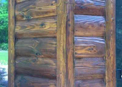 Log home after media blasting and staining process to enhance the natural beauty of the logs
